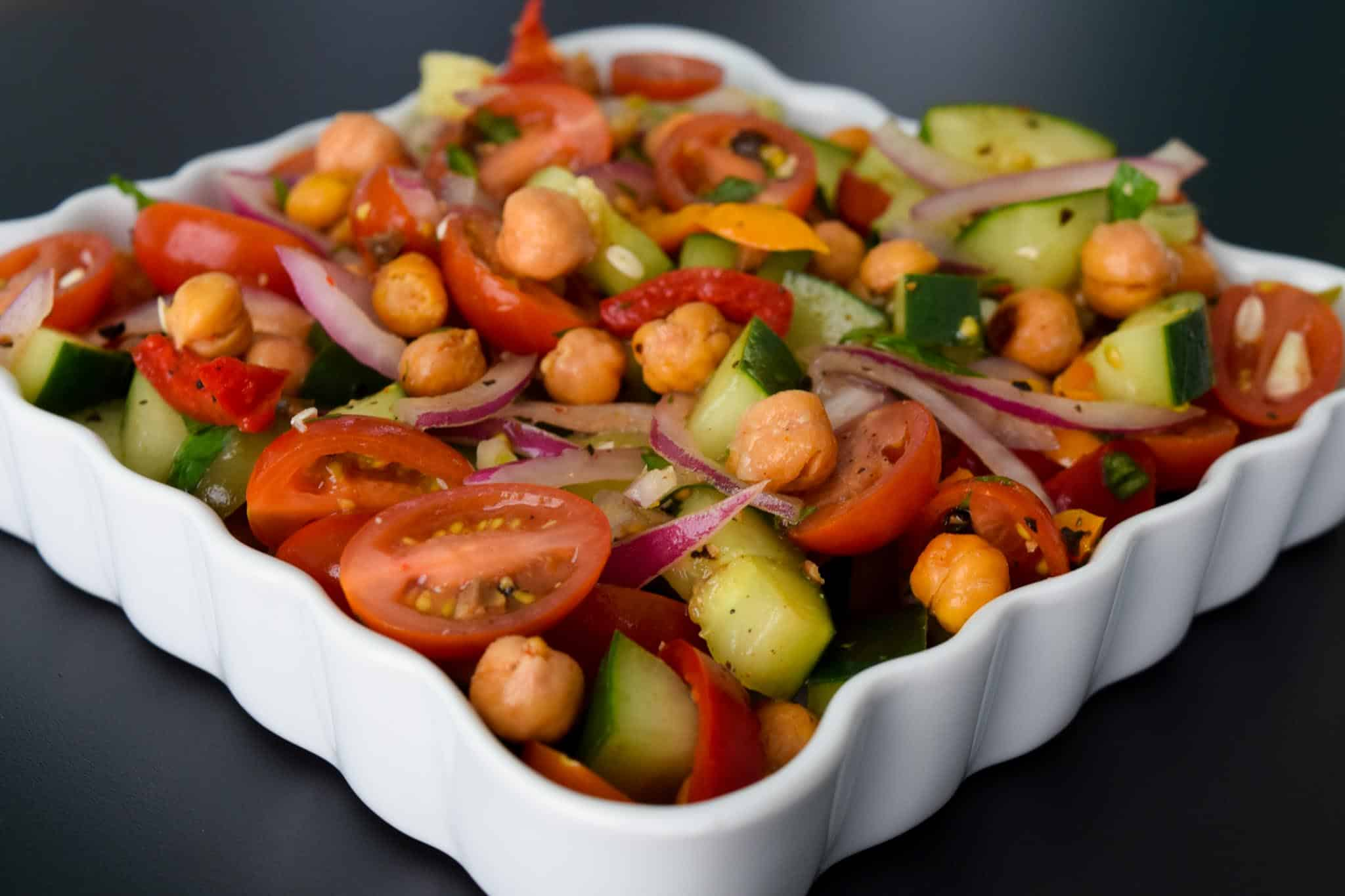 Roasted Chickpea Panzanella Salad in white serving tray close up view