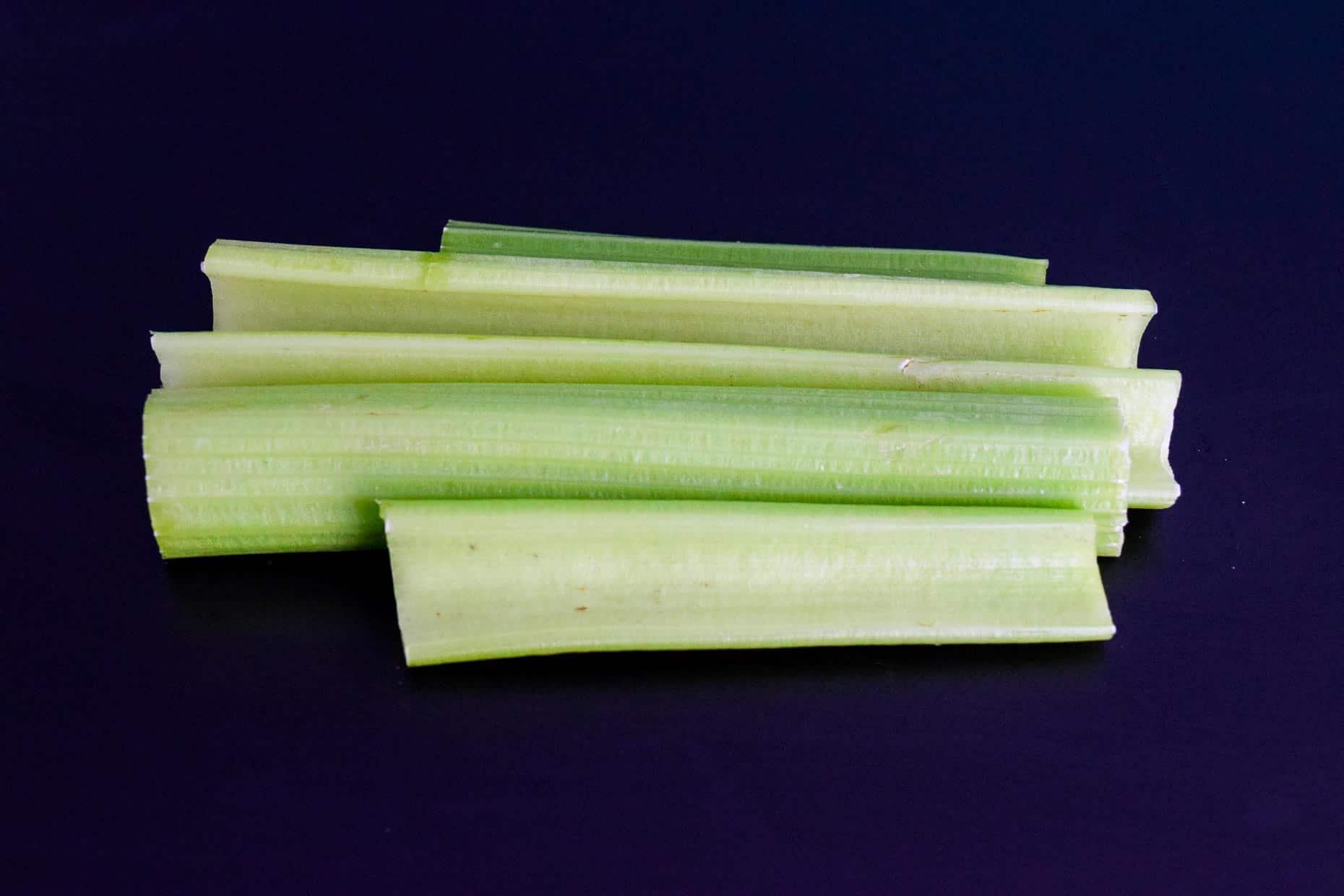 Celery on black background