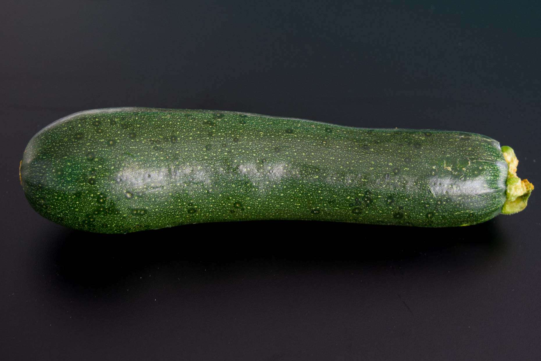 Zucchini on black background