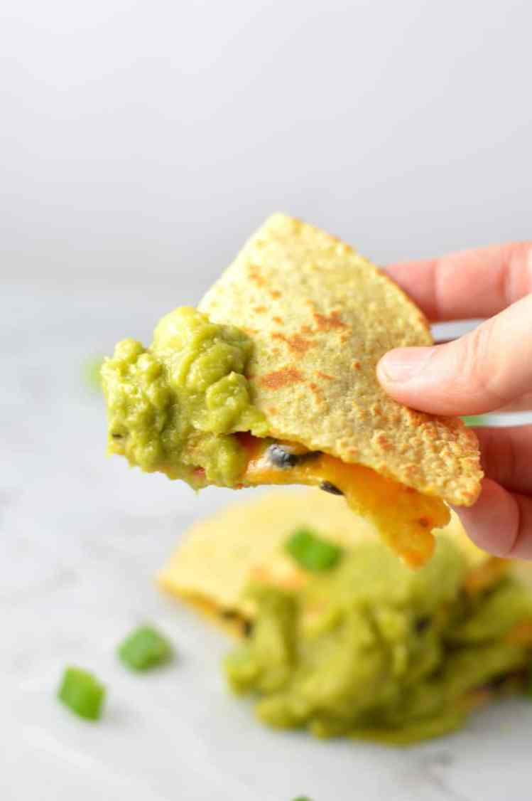 quesadilla dipped in guacamole