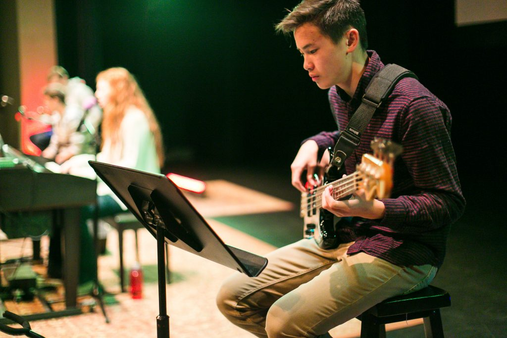 Student performing for an Event
