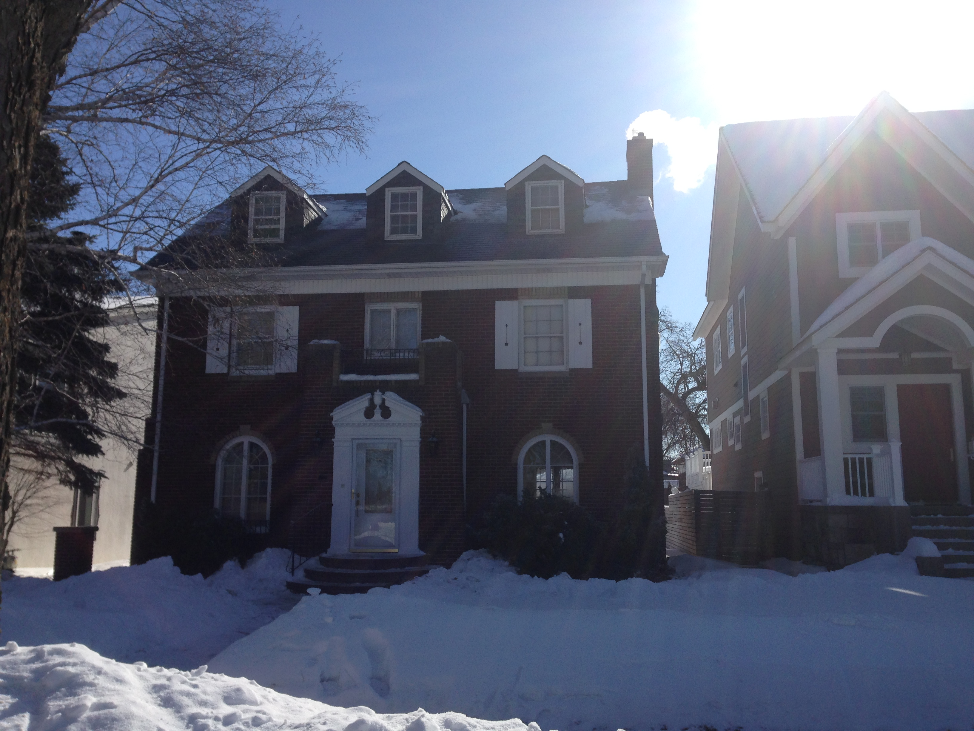 Ice Dam removal projects in WNY photo of home with steamed roof