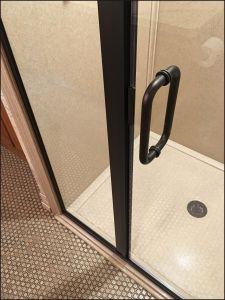 Oil rubbed bronze shower door replacement. Brooklyn Park bathroom remodeling