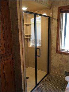 Replacement shower project with semi frame-less hinged shower door in Minneapolis, MN