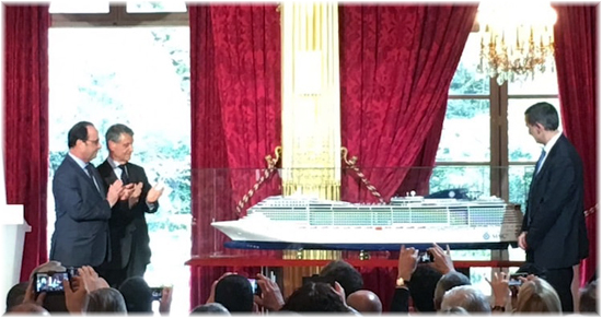 Laurent Castaing (R), President of French shipyard STX France, Mediterranean Shipping Company (MSC) Chairman Gianluigi Aponte (C), and French President Francois Hollande (L) stand next to the model of the MSC Preziosa