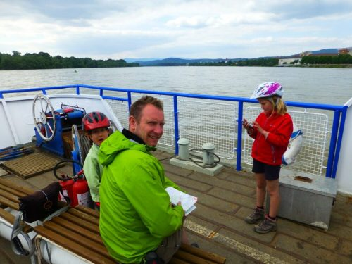 Taking the boat along the River Danube with bikes and kids