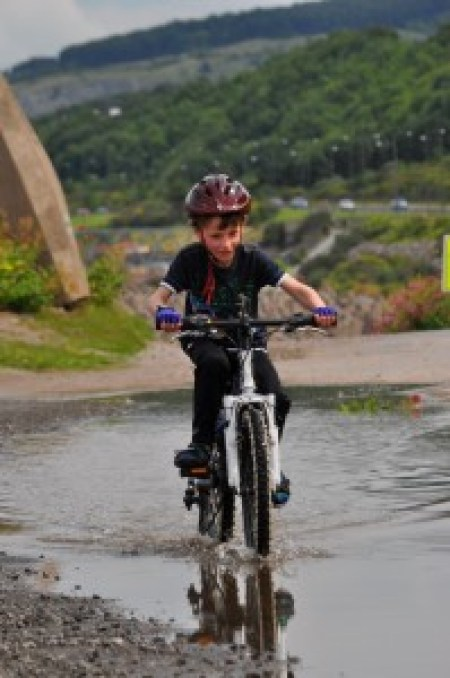 Riding in puddles on the NCN5 near Rhos-on-Sea