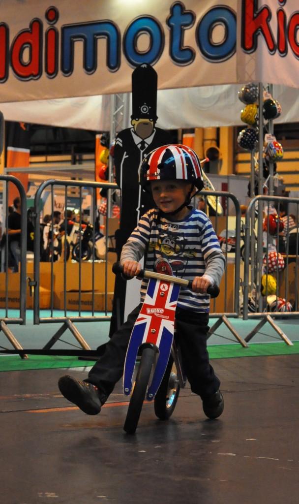 Image of child riding the Kiddimoto Kurve Union Jack Balance Bike review test ride