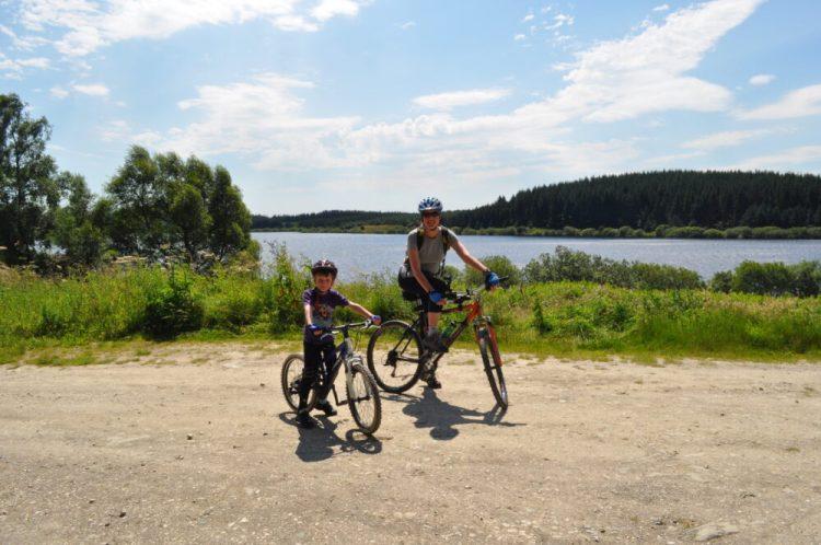Family bike ride at Alwen Reservoir
