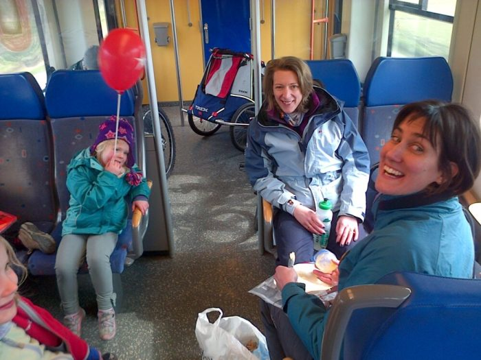 On Dutch trains with children's bikes, adult bikes and trailers during our family cycling holiday to Holland