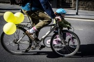 Young child riding bike during Pedal on Parliament