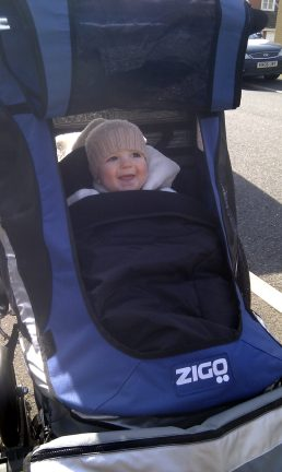 Zigo Leader tricycle for carrying children - Alby looking very happy and comfy