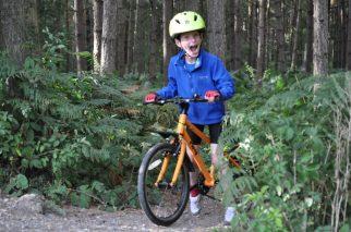 Proviz Eris bright yellow kids cycle helmet with a light on the back