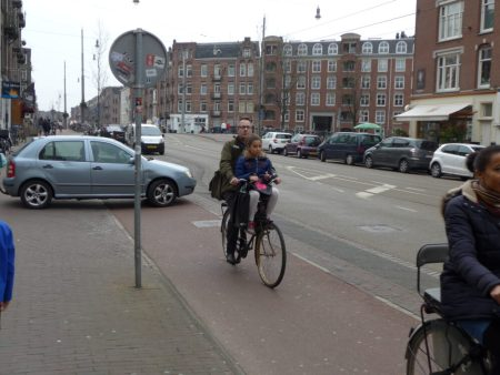 Photo of cycling with child on front of bike in Amsterdam, Holland 2016