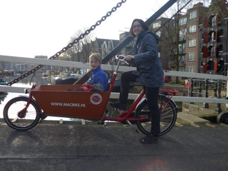 Cycling with a cargo bike in Amsterdam