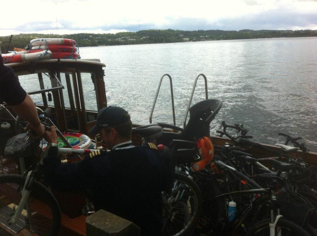 Loading bike with kids bike seat onto the Windermere Bike Boat