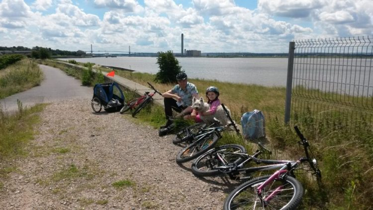Enjoying a rest during a family cycle ride at Rainham Marshes RSPB nature reserve