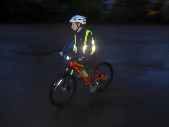 Cycling in the dark - using a hi-vis vest will help make your child visible to drivers in the dark