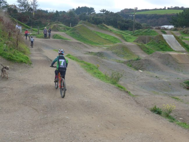Riding the balance bike course at The Track, Cornwall