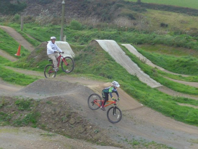 Dad cycling at The Track bike park in Cornwall