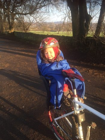 Callum taking a test ride in the Huby Muffle