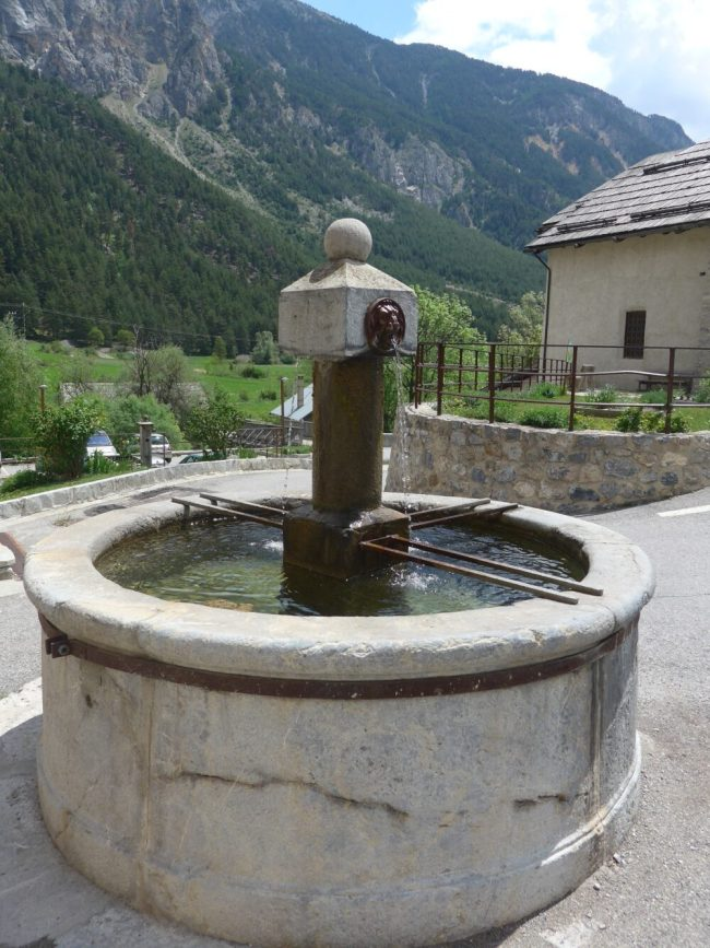 Fountains are a great place to fill your water bottle when family cycling in France