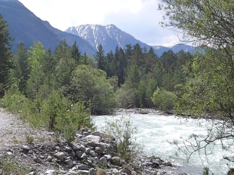 Vallée de la Clarée in the French Alps - river with mountains in background