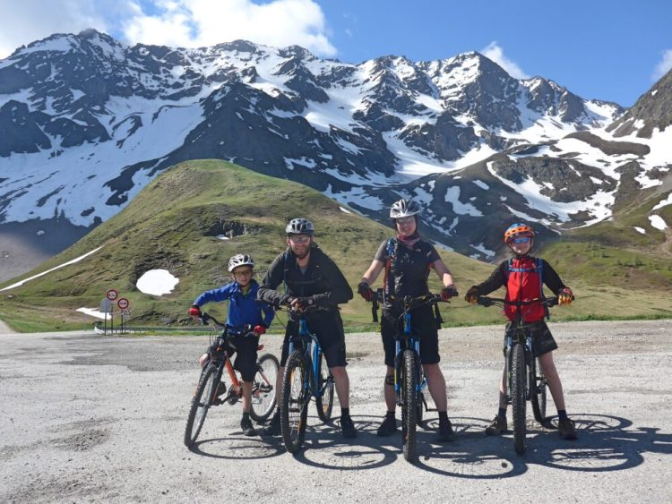 Family Cycling from the top of the Col du Lautaret, French Alps