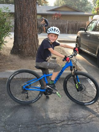 8 year old riding an XS Trek Cali SL 13.5