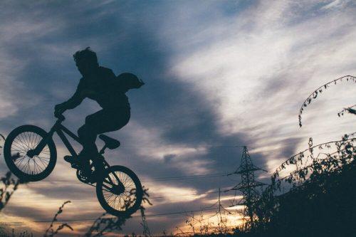 Photo of child cycling without a cycle helmet = Photo by Julia Komarova on Unsplash