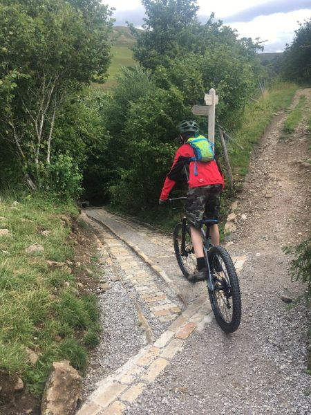 Steep descent out of Keld on the Swale Trail Yorkshire Dales