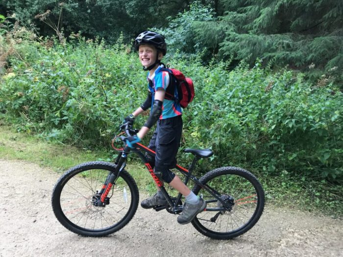 Big smiles from our reviewer of the Frog MTB 69 kids 26 inch wheel mountain bike