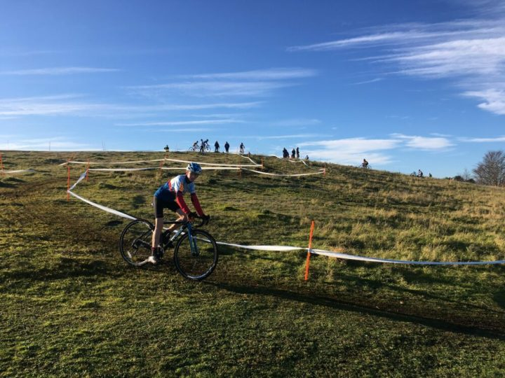 Riding in a junior British Cycling cyclocross U14's kids cycle race (CX)