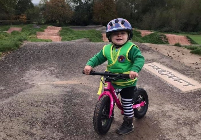 Girl on Balance Bike at Pump Track