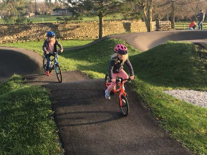Girls on bicycles - at the pump track