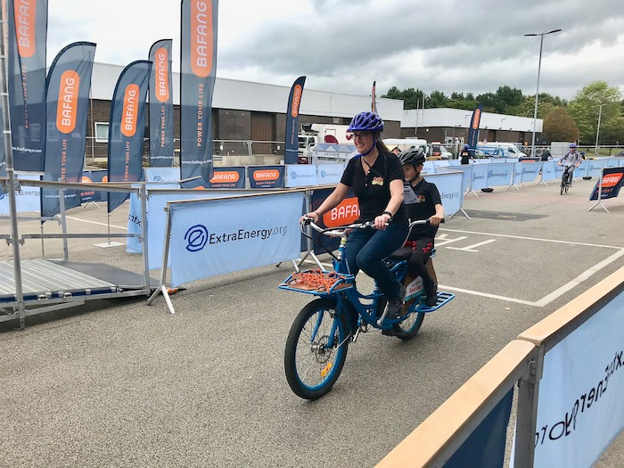 family cargo bikes at the 2019 Cycle Show - Pedego Stretch in action