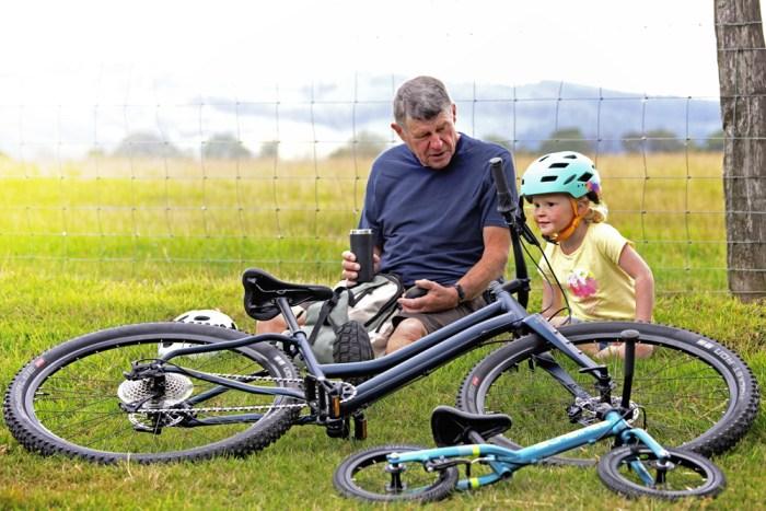 Islabikes new 2020 range bikes and riders sitting on grass