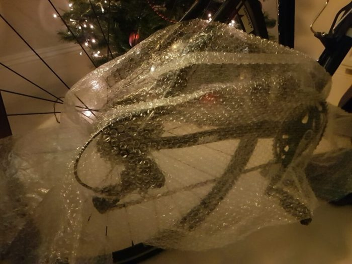 How to stop getting oil on blanket when wrapping a kids bike for Christmas