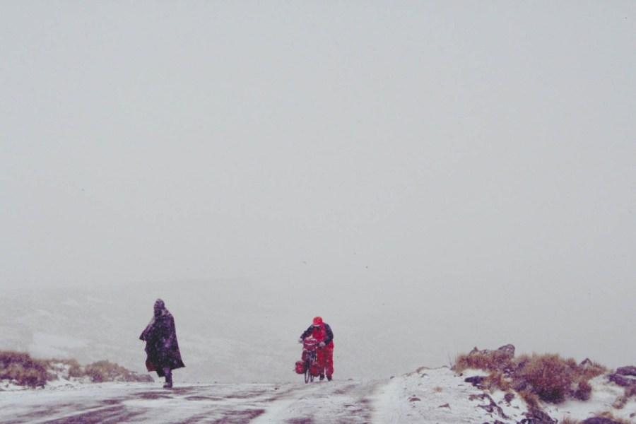 walking uphill in a blizzard