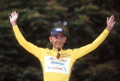 Marco Pantani wearing the yellow jersey after winning the Tour de France in Paris, 1998 – Credit: SVEN SIMON/DPA/Press Association Images