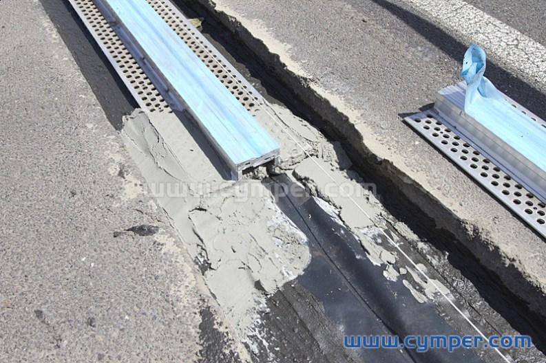 Reparación de junta de dilatación en pavimento asfáltico - 06