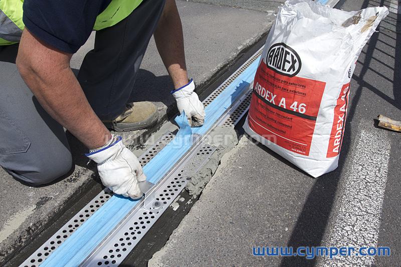 Reparación de junta de dilatación en pavimento asfáltico - 07