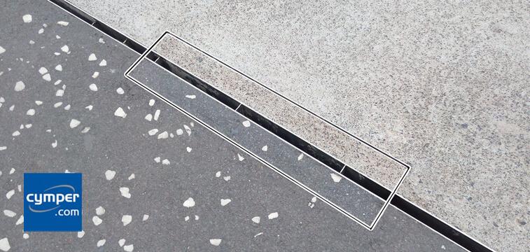 Ejemplo transición de pavimentos y registro rellenable para rejilla ranurada oculta tipo slot.