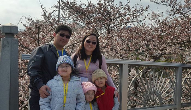 family with cherry blossoms in jeju island