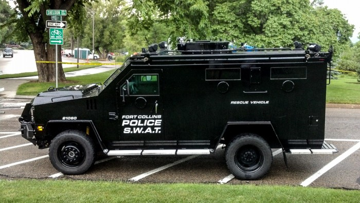 "SWAT at 4th of July. I love the ""rescue vehicle"" on the side.  I feel safer already."