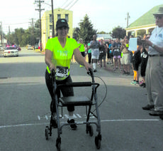 "<div class=""source"">Photo courtesy of Jeri Stracner</div><div class=""image-desc"">Kristen Crawford crosses the finish line to the sound of cheers and applause in her first ever 5K run.</div><div class=""buy-pic""><a href=""http://web2.lcni5.com/cgi-bin/c2newbuyphoto.cgi?pub=081&orig=viewpoint_5krun.jpg"" target=""_new"">Buy this photo</a></div>"