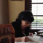 Cynthia signing books.
