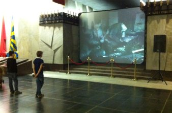 Two boys watch the Memorial film