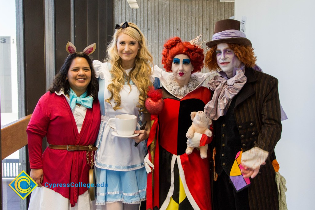 Staff dress as characters from Alice in Wonderland for campus Halloween party