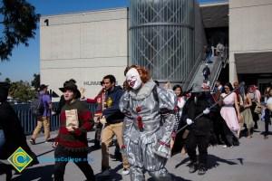 Students walking across campus in Halloween costumes